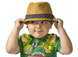 Photo of Little Boy Holding Hat on Head